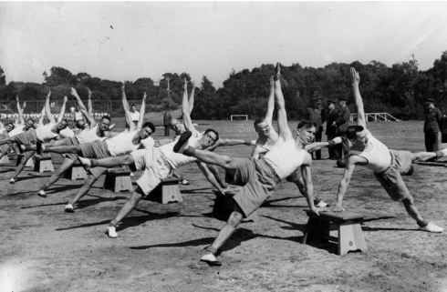 Physical training at P. T. & R. School (ca 1942) Image Courtesy of the State Library of Victoria,Argus newspaper collection of war photographs. World War II. Image No. H98.105/4467  http://handle.slv.vic.gov.au/10381/197430