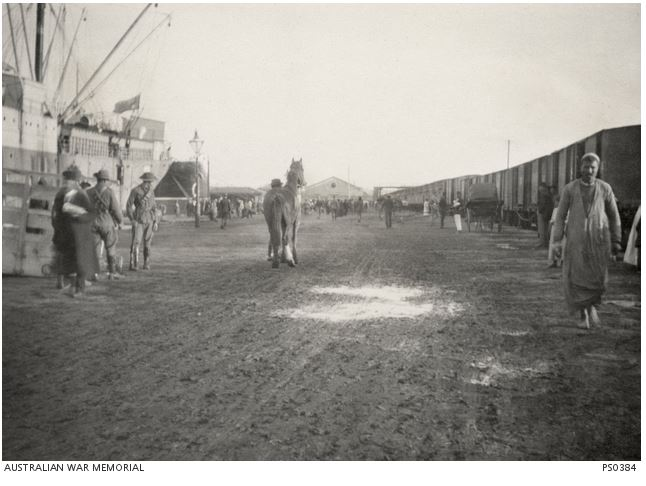 THE 4TH LIGHT HORSE UNLOADING AT . Image courtesy of the Australian War Memorial. Image no. PS0384 http://www.awm.gov.au/collection/PS0384/