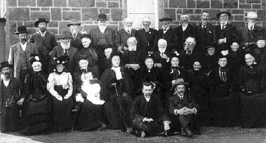 BYADUK PIONEER DAY - March 27, 1907.  JAMES HARMAN (Back Row, 6th from right), JONATHAN HARMAN (Back Row, 5th from right), ELIZABETH OLIVER, widow of REUBEN HARMAN (Front row, 2nd from right).  Photo courtesy of the Hamilton History Centre.