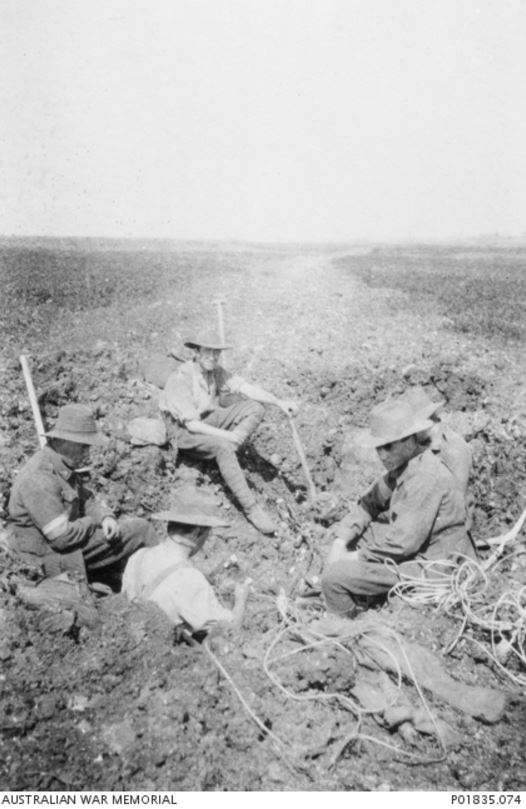 Men from the 2nd Divison Signal Company repair phone lines near Gilsy, France. 1918. Image courtesy of the Australian War Memorial https://www.awm.gov.au/collection/P01835.074