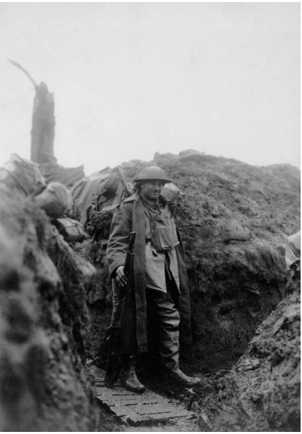 A MEMBER OF THE 39TH BATTALION IN WINTER CLOTHING IN THE TRENCHES AT HOUPLINES DURING DECEMBER 1916. Image courtesy of the Australian War Memorial. https://www.awm.gov.au/collection/E00086/