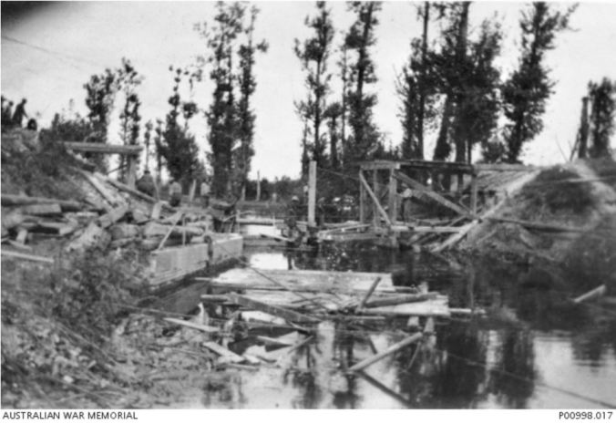 September 1918 - Members of the 2nd Pioneer Battlaion construct a bridge over a canel near the river Somme. Image courtesy of the Australian War MEmorial. https://www.awm.gov.au/collection/P00998.017